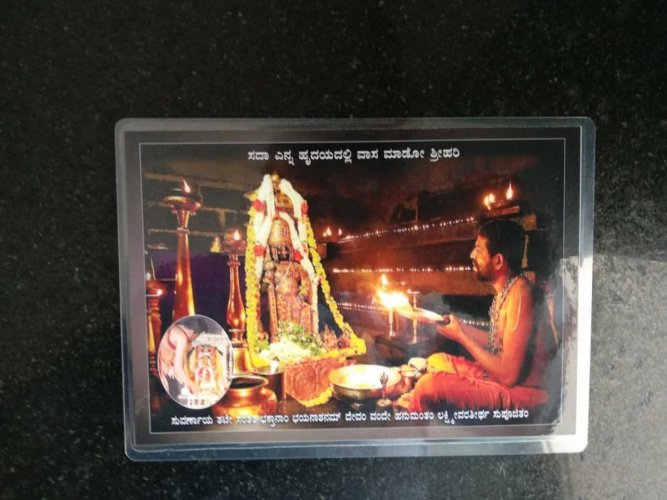 Those who attended the ritual were given a photo and book written by P Latavya Acharya.