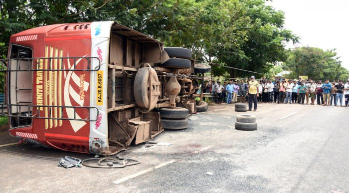 A private bus overturned and fell on a moving car at Adyar on the outskirts of Mangaluru on Wednesday.