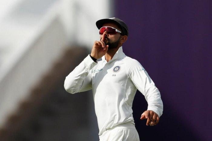 Virat Kohli celebrates after running out England's Joe Root. Reuters