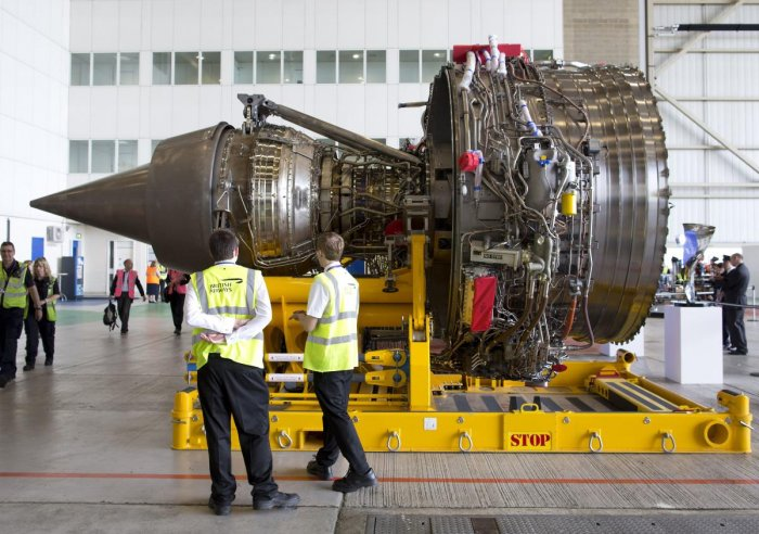 Staff look at a Rolls-Royce Trent 1000 turbofan engine during an event to mark the arrival of a British Airways Airbus A380 at Heathrow Airport in London. (AFP File Photo)