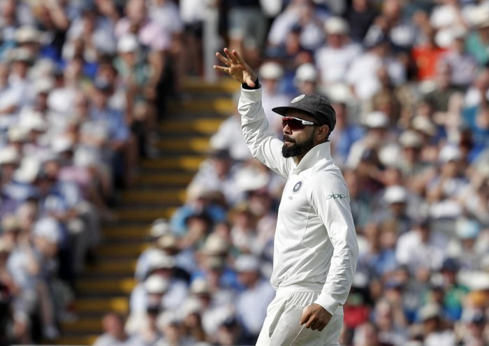 India's captain Virat Kohli enacts 'mic drop' after running out England's Joe Root on the first day of the first Test at Edgbaston on Wednesday. AFP