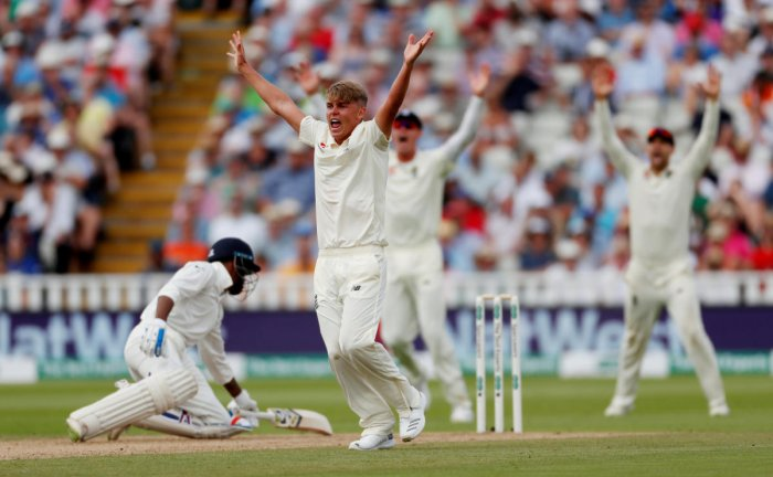 FIERY: England's Sam Curran successfully appeals for the wicket of Hardik Pandya on the second day of the first Test at Edgbaston on Thursday. Reuters