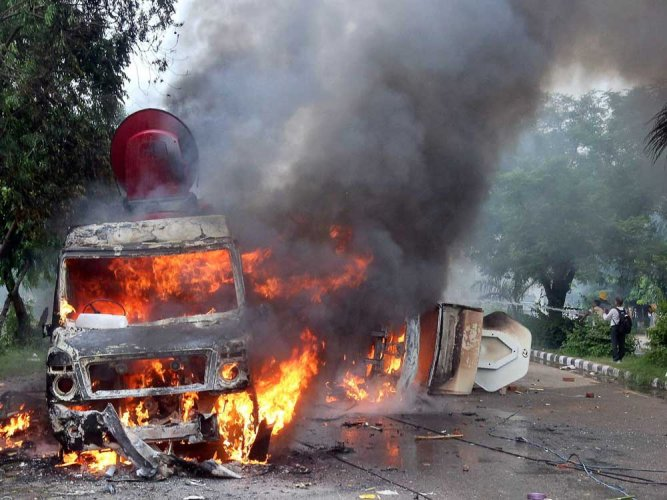 The police have failed to produce substantial evidence in Court against Dera followers who ran amok that ill-fated day on August 25 last year burning media OB vans and public property. PTI file photo
