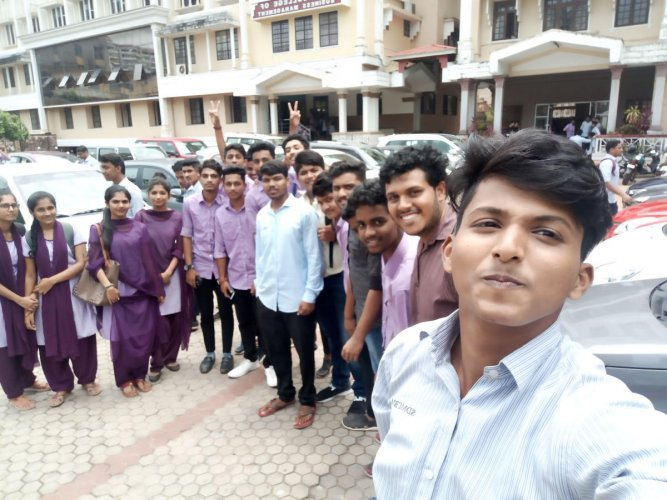Students pose for a selfie as part of the campaign against drug abuse on campus in Mangaluru.