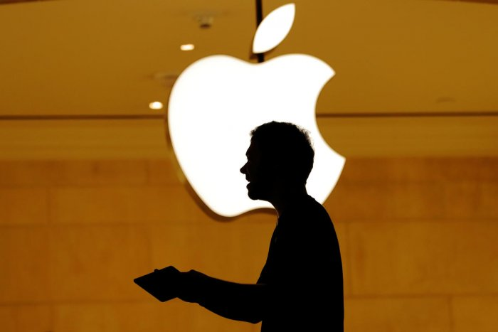 Customers walk past an Apple logo inside of an Apple store at Grand Central Station in New York. REUTERS