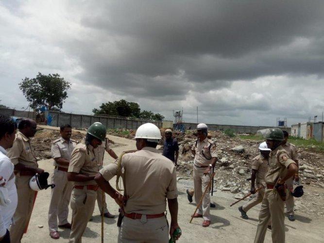 Policemen deployed near Sri Cement Factory near Kodla in Sedam taluk. DH Photo