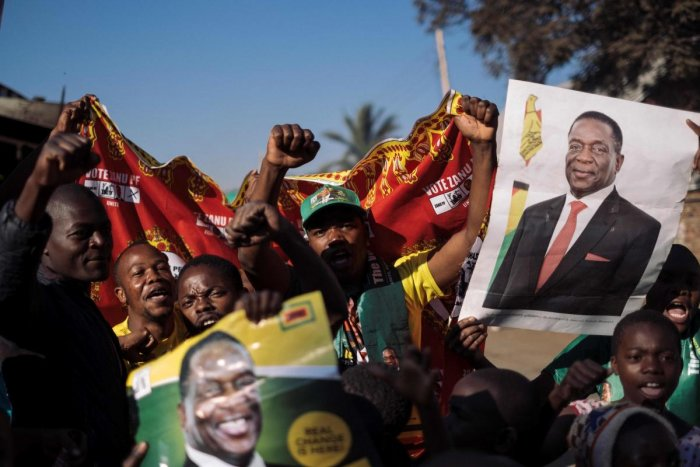 Supporters of the newly reelected Zimbabwe President Emmerson Mnangagwa celebrate in Mbare, Harare, on August 3, 2018. AFP