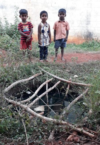 Poorvika (5) with Deepak (5) and Satwik (6) near the sump at Appegowdanahalli in Shidlaghatta taluk.