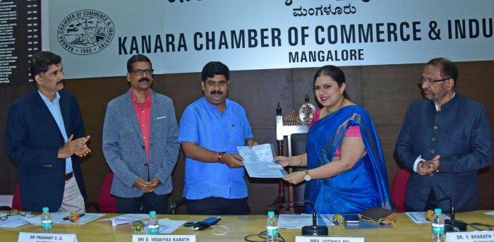 Kanara Chamber of Commerce and Industry President Vathika Pai submits a memorandum to Mangaluru City South MLA D Vedavyas Kamath at an interactive meeting in Mangaluru on Friday. KCCI Vice-President P B Abdul Hamid looks on.