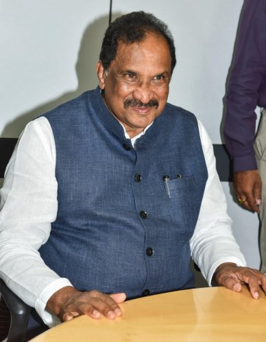 Minister K J George at the Deccan Herald office in Bengaluru on Friday. DH Photo