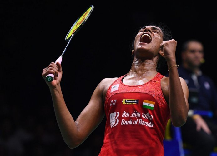 P V Sindhu celebrates after defeating Nozomi Okuhara of Japan in their women's singles quarterfinal of the badminton World Championships in Nanjing on Friday. AFP
