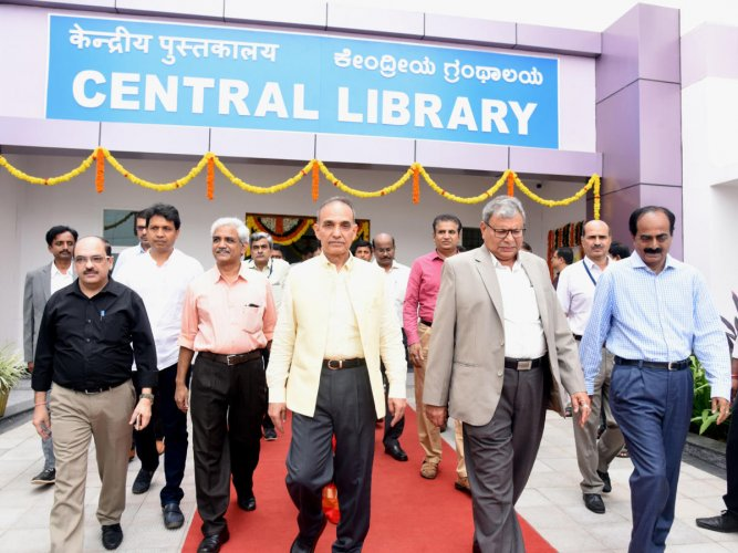 Union Minister of State for HRD and Water Resources Satyapal Singh and other dignitaries come out after inaugurating e-digital library at NITK, Surathkal, on Saturday.