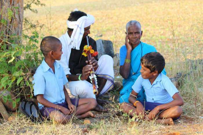 Folk Music Ramanna, a Ganey artiste, playing the instrument; (below) Ramanna holding the Ganey. photos by author