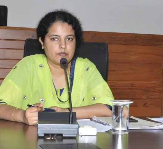 Udupi DC Priyanka Mary speaks at a meeting in Udupi on Saturday.