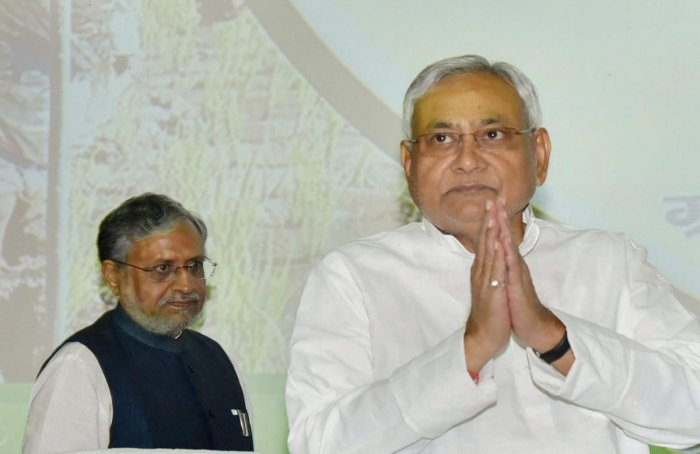 Bihar Chief Minister Nitish Kumar with Deputy Chief Minister Sushil Kumar Modi during the launch of Sustainable Livelihoods scheme for prohibition-affected families, at Adhiveshan Bhawan in Patna on Sunday. PTI