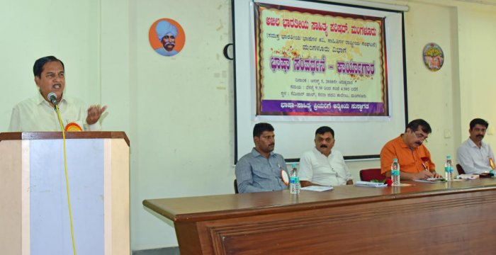 Prof H M Maheshwariaiah, vice chancellor of the Central University, Kalaburagi, delivers the inaugural address during a workshop on language enrichment at Canara First Grade College in Mangaluru on Sunday. Alva's Education Foundation chairman Dr Mohan Alva and Akhila Bharatiya Sahitya Parishat State General Secretary Raghunandan Bhat look on.
