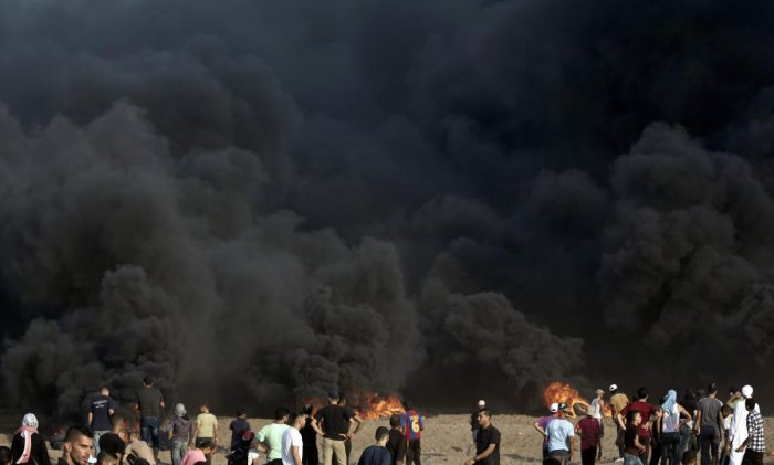 Palestinian protesters gather during a protest at the Gaza Strip's border with Israel.