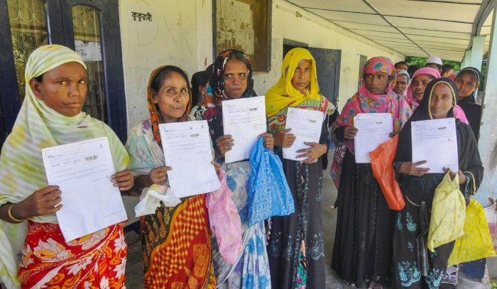 People queue at an office to verify and check their names in the final draft of the National Register of Citizens (NRC), at Morigoan on Saturday, Aug 4, 2018. (PTI Photo)