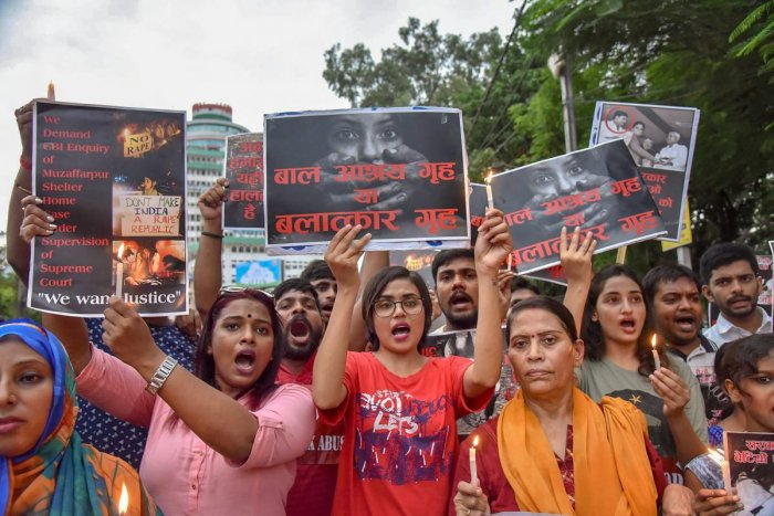 Members of different organisation stage a protest march against the recent incident of Muzaffarpur shelter home rape case, in Patna. (PTI Photo)