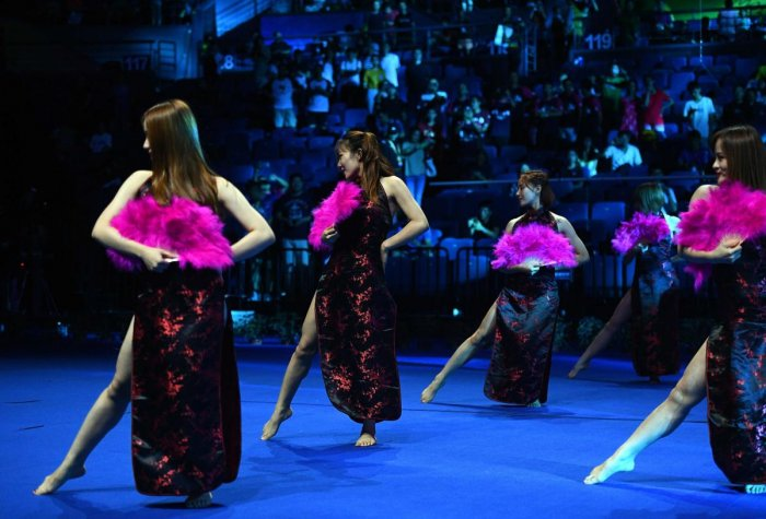 This picture taken on August 5, 2018, shows dancers performing during the Badminton World Championships in Nanjing, Jiangsu province.