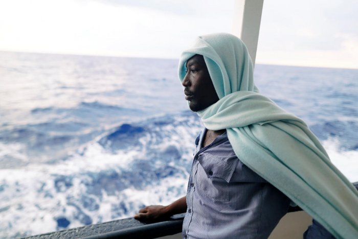 A migrant stands on board NGO Proactiva Open Arms rescue boat in central Mediterranean Sea, August 5, 2018. REUTERS