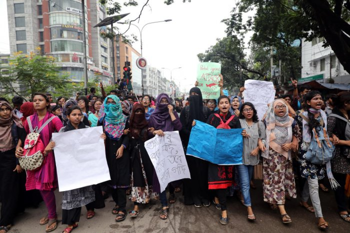 Students shout slogan during a rally as they join in a protest over recent traffic accidents that killed a boy and a girl, in Dhaka, Bangladesh, August 5, 2018. REUTERS