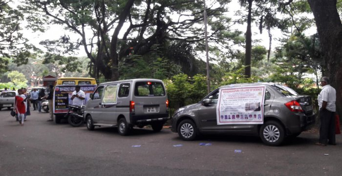 The vehicles of private colleges on the Central College campus on Monday.