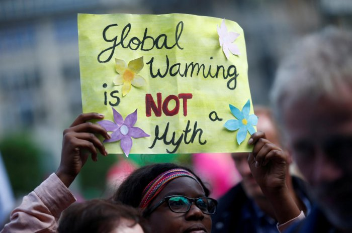 """People take part in protests ahead of a G20 summit in Hamburg, Germany July 2, 2017. Placard reads """"Global Warming is NOT a Myth"""". (REUTERS File Photo)"""