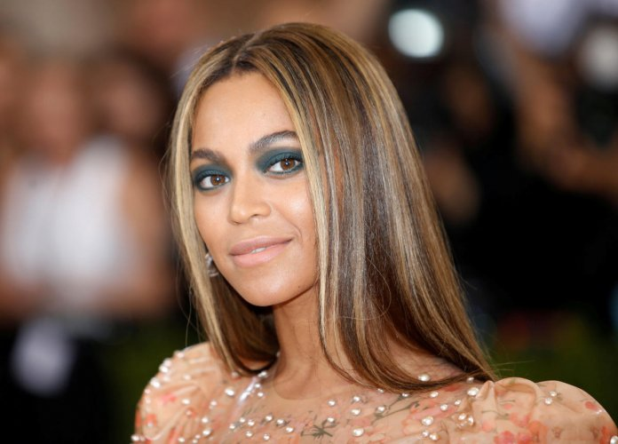 """FILE PHOTO: Singer-Songwriter Beyonce Knowles arrives at the Metropolitan Museum of Art Costume Institute Gala (Met Gala) to celebrate the opening of """"Manus x Machina: Fashion in an Age of Technology"""" in the Manhattan borough of New York, U.S., May 2, 201"""