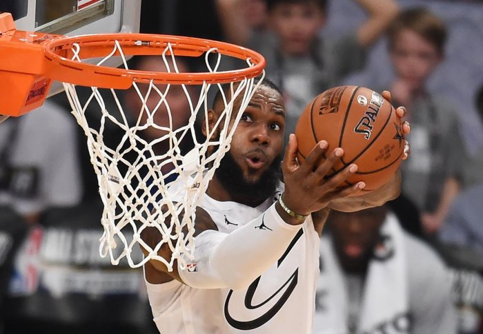 (FILES) In this file photo taken on February 18, 2018 LeBron James sinks a basket during the 2018 NBA All-Star Game at Staples Center in Los Angeles, California. Basketball great LeBron James on July 31, 2018 accused President Donald Trump of intensifying