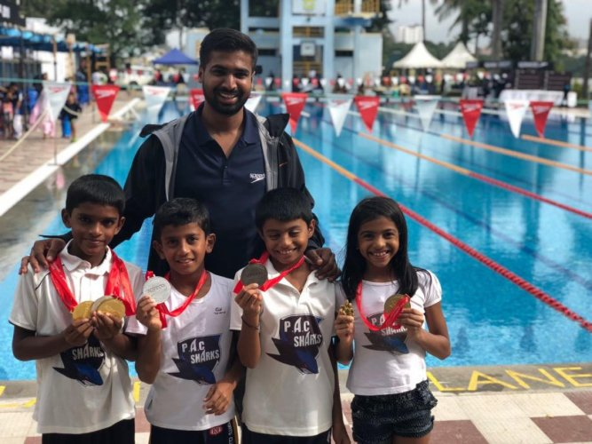 Puttur Aquatic Club swimmers Diganth V S, Amanraj, Anvith Rai Barike and Siya Bhavin Savjani proudly display their medals won at the SPEEDO Invitational Swimming Championship 2018 held in Bengaluru recently.