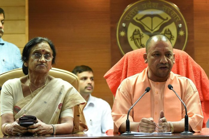 UP Chief Minister Yogi Adityanath and Women and Child Welfare Minister Rita Bahuguna Joshi address a press conference to recommend CBI probe into the Deoria shelter home case, in Lucknow on Tuesday. PTI