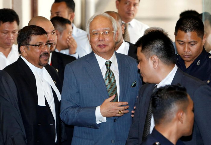 Malaysia's former prime minister Najib Razak walks out of a courtroom in Kuala Lumpur, Malaysia August 8, 2018. (REUTERS/Lai Seng Sin)