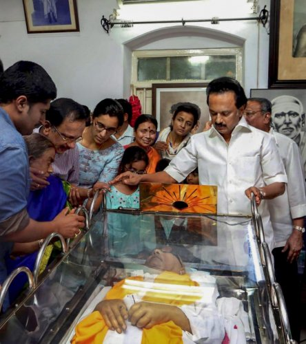 Chennai: DMK leader MK Stalin stands alongside the mortal remains of his father and DMK chief M Karunanidhi, in Chennai on Wednesday, Aug. 08, 2018. Karunanidhi died yesterday after a prolonged illness, in the city hospital where the leader was admitted.