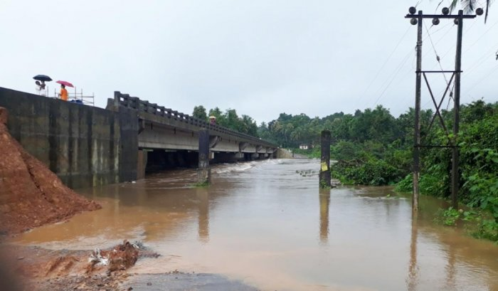The inundated Hosamata bridge near Kadaba. As work on the new bridge is incomplete, vehicles use the old bridge.