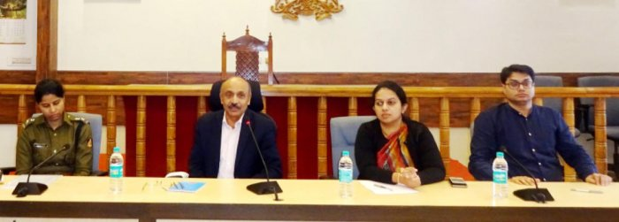State Chief Information Commissioner Dr Suchetana Swaroop speaks during a meeting at the DC's office hall in Madikeri onWednesday. District Superintendent of Police Sumana D Pannekara, Deputy Commissioner P I Srividya and Zilla Panchayat CEO Prashant Kumar Mishra look on.
