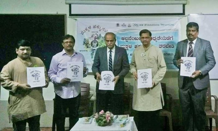 Judge Acharya released a booklet on child rights on the occasion.
