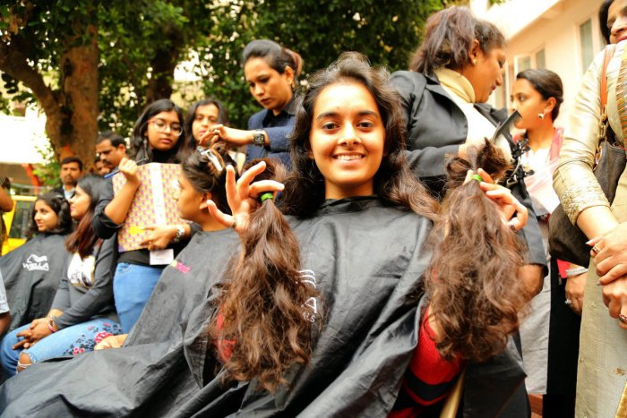 Students of Mount Carmel College donating their hairs during the Gift hair Gift confidence campaign for Cancer patients at College premises organised by The Cherian Foundation in Bengaluru on Wednesday 09th August 2018.