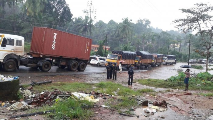 Vehicles line up on National Highway 75 near Udane of Shiradi village as floodwater from the Gundya stream gushes onto the road, blocking the movement of vehicles