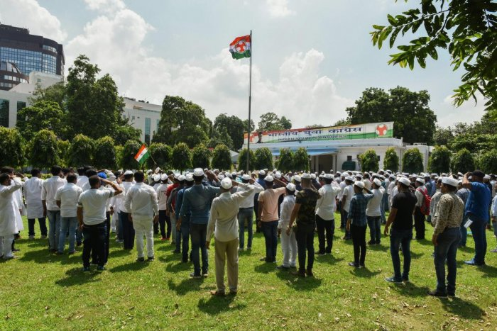 Indian Youth Congress members salute party flag during their Foundation Day celebrations, at IYC National Office in New Delhi on Thursday, Aug 9, 2018. (PTI File Photo)