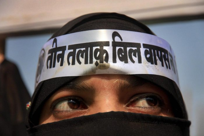 A burqa-clad woman looks on during a protest against the proposed Triple Talaq bill in Mumbra near Mumbai. (PTI File Photo)