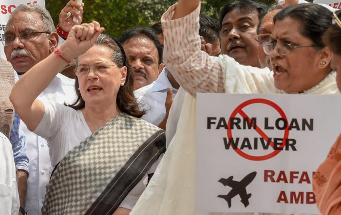 New Delhi: UPA chairperson Sonia Gandhi along with other opposition parties' leaders raises slogans during a protest against the Union government over Rafale deal issue, at Parliament House in New Delhi on Friday, Aug 10, 2018. (PTI Photo/Kamal Singh) (PT