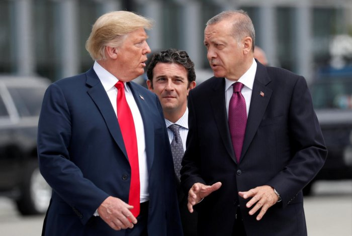 US President Donald Trump and Turkish President Tayyip Erdogan at the start of the Nato summit in Brussels, Belgium on July 11, 2018. Reuters