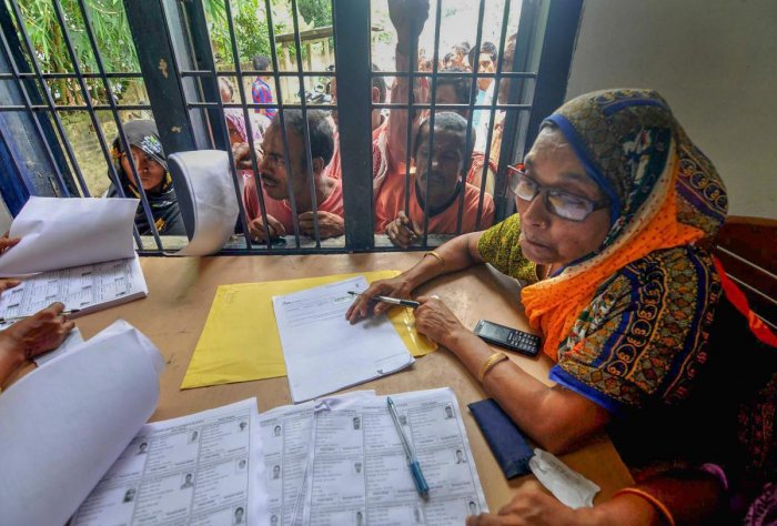 People wait in a queue to check their names on the final draft of the state's National Register of Citizens after it was released, at an NRC Seva Kendra, in Morigaon. (PTI File Photo)