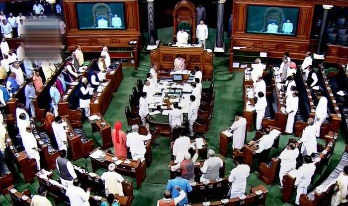 Members stand for the national anthem in the Lok Sabha on the last day of the monsoon session of Parliament, in New Delhi on Friday. PTI
