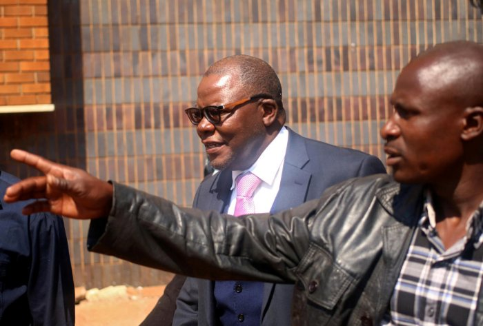 Zimbabwe's former finance minister and opposition leader Tendai Biti looks on after appearing at the Magistrate Court in the capital Harare on August 10, 2018. Reuters