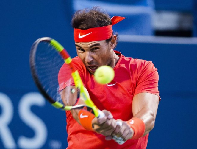 Rafael Nadal, of Spain returns during his win over Croatia's Marin Cilic in the quarterfinal of the Rogers Cup. AP/PTI