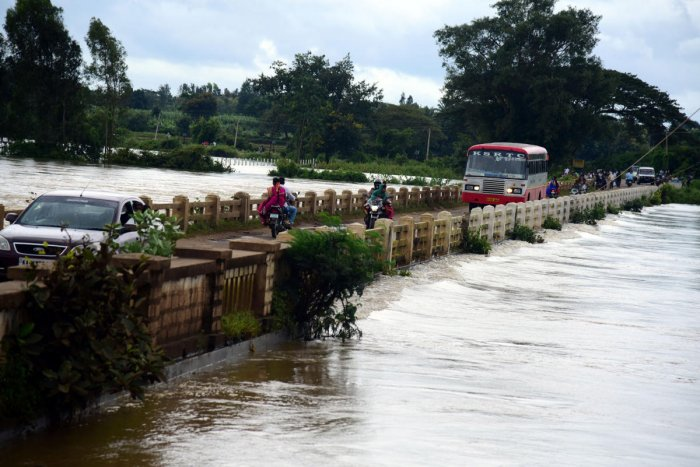 A bridge is on the verge of getting submerged in the Kapila waters in H D Kote taluk of Mysuru district on Saturday.