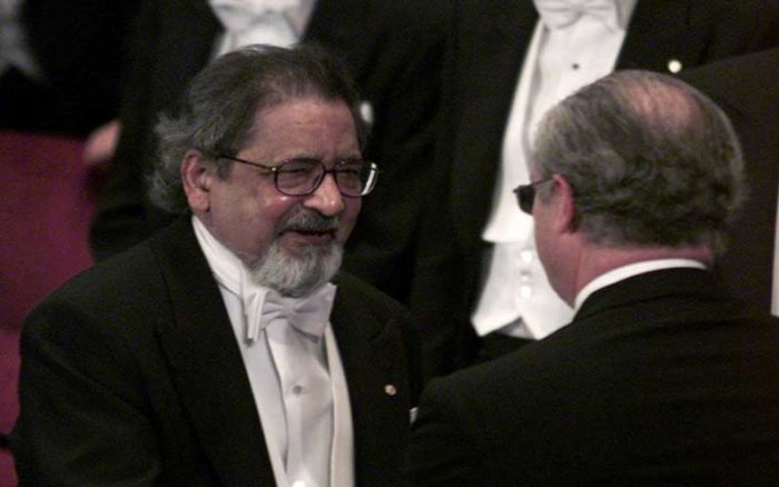 File photo of V.S. Naipaul receiving his Nobel prize for literature at Stockholm's Konserthuset from Sweden's King Carl Gustaf. (Reuters)