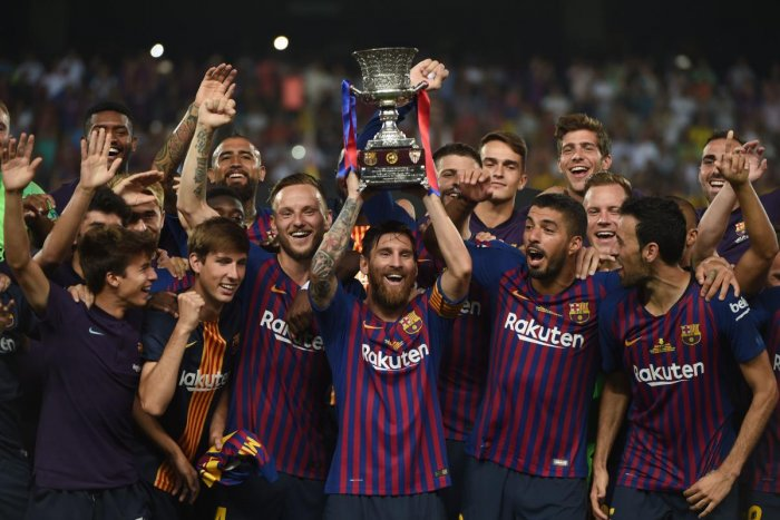 Barcelona with the trophy after winning the Spanish Super Cup on Sunday. AFP